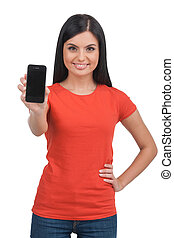 Woman with mobile phone Cheerful young woman holding mobile...