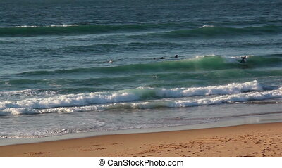 Small waves splashing and approaching the sea shore -...