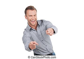 Man pointing. Cheerful young man pointing camera and smiling...