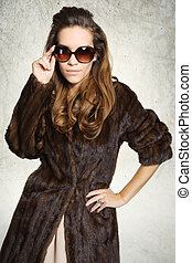 Mysterious elegant woman in a fur c