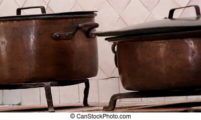 A group of cooking pots set of brown pot