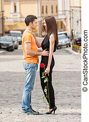 Loving couple. Full length of beautiful young loving couple hugging and looking at each other
