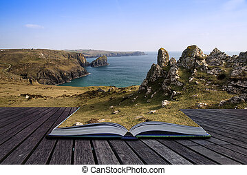 Creative concept pages of book Kynance Cove cliffs looking...
