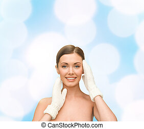 smiling young woman in white mittens - beauty, winter, spa...