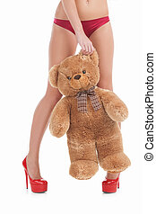 Woman with toy bear. Cropped image of young women in red...