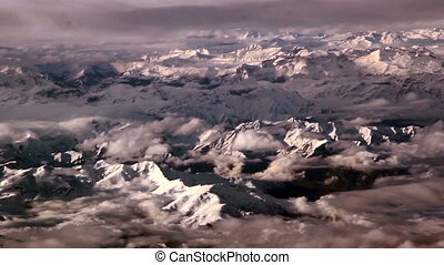 Clouds above rocky mountains thin clouds and the white...