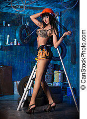 hot work - Stunningly sexual girl posing with tools in the...