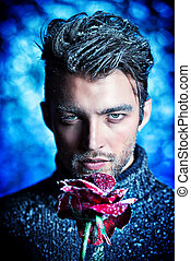 frozen rose - Portrait of a handsome man dressed in winter...