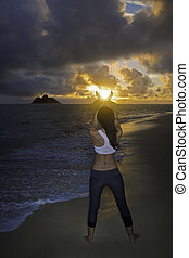 woman on the beach at sunrise