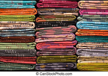 Colorful fabric rolls - Heap of cloth fabrics at a local...