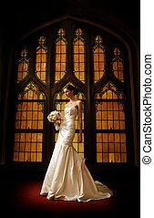 Beautiful bride against stained glass window