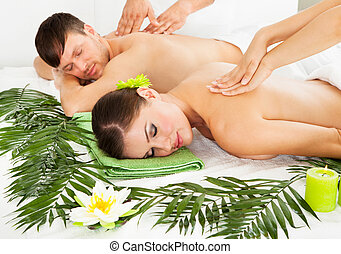 Happy Couple Getting Spa Treatment - Attractive Couple Lying...
