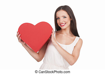 Girl with heart. Beautiful young woman holding paper heart...