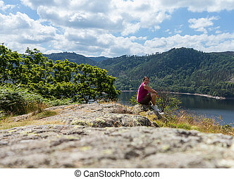 Female hiker overlooking Thirlmere - Female young hiker...
