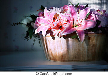 lily flower in wood bucket with cookie light decorated in...