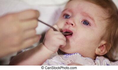 Feeding a baby spoon