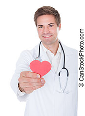 Doctor Holding Heart - Portrait Of A Happy Male Doctor...