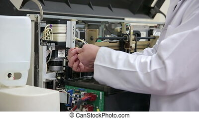 Preparing laboratory equipment - Male technician preparing...