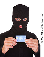 Burglar Holding Credit Card - Portrait Of A Burglar Putting...