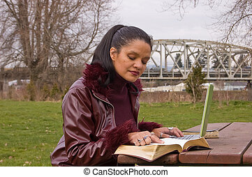 Young Professional Woman Studying at Park with Laptop...