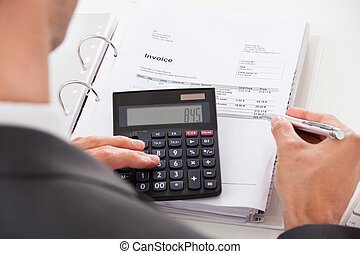 Businessman Using Calculator - Happy Young Businessman...