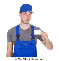Mechanic Holding Visiting Card - Portrait Of Happy Mechanic...