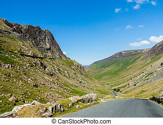 Honister pass in Lake District - Narrow road leads down from...