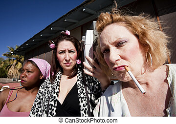 Three Trashy Women - Portrait of three trashy women outdoors...
