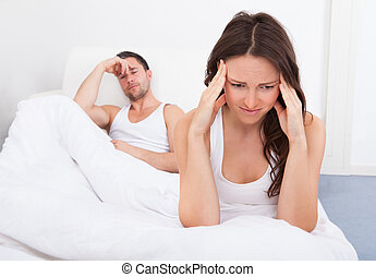 Unhappy Couple On Bed - Frustrated Woman Sitting On Bed In...