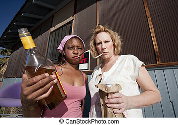Drunk Women - Portrait of two trashy drunk women outdoors