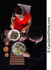 Young Couple Having Dinner With Wine - Overhead View Of...