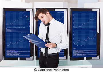 Stock Broker Working At Office - Stock Broker Using...