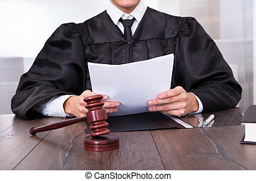 Judge Holding Documents - Close-up Of Male Judge In Front Of...