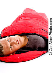 adult caucasian male resting in sleeping bag