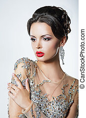 Elegance. Luxurious Good Looking Woman in Dress with Sequins...