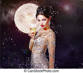 Romantic girl in the beautiful dress with a glass of...