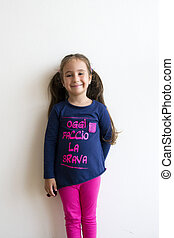 Beautiful little girl with funny inscription