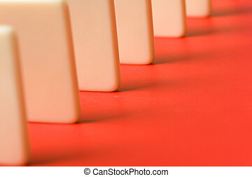 Domino with red background, Concept of Cause or Teamwork