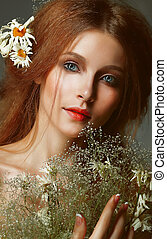 Pure Beauty. Auburn Girl holding Bouquet of Wildflowers....