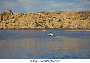 Watson Lake Kayaking - woman kayaking on scenic watson lake...