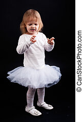Little ballerina - Two years old baby girl wearing white...
