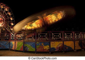 Fun fair at night. Blurred lights.