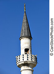 Minaret - small minaret with megaphone on blue sky