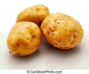 Potatos - Potatoes on a white background. Studio work.