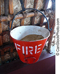 Fire bucket - A red fire bucket with white text