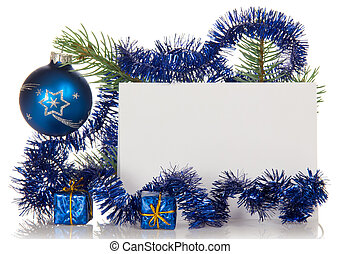 Fir-tree branch with tinsel, small gift boxes, Christmas -...