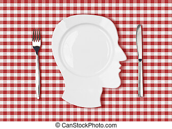 head dish or plate on red picnic tablecloth with knife and...