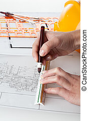 Architect work - Close up of architect working on blueprints