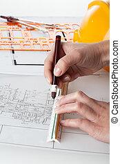 Architect work - Close up of architect working on blueprints