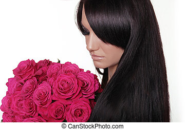 Healthy long hair. Brunette woman with fringe holding pink bouquet of roses isolated on white background. Hairstyle.